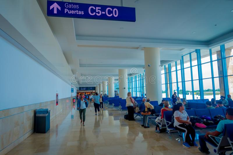 CANCUN, MEXICO - NOVEMBER 12, 2017: Unidentified people waiting in the chairs located at the Interior of Cancun stock image