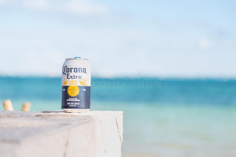 CANCUN, QR, MEXICO - FEB 4, 2019: Close-up of can of traditional Mexican Corona beer with a white sand beach with stock photos