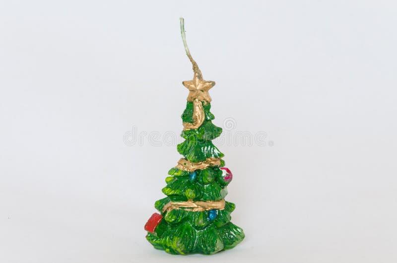 Candela di Natale con una stella su un fondo bianco fotografia stock