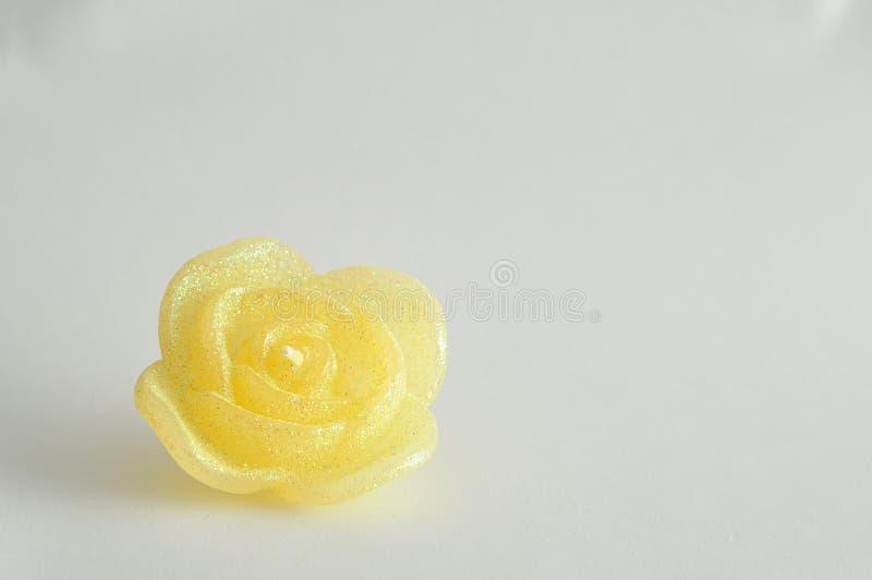 Candela sotto forma di una rosa immagine stock