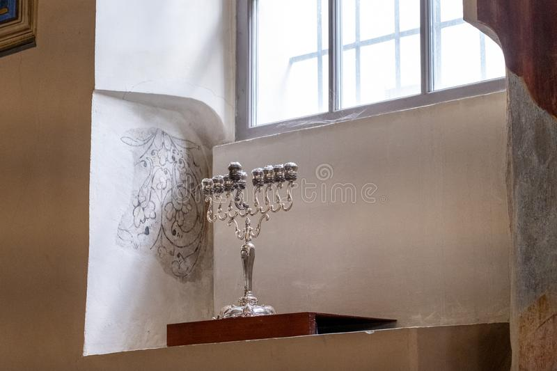 Candelabra in the 17th century Kupa Synagogue in Kazimierz, the historic Jewish quarter of Krakow, Poland. Interior view of the beautiful 17th century Kupa stock image