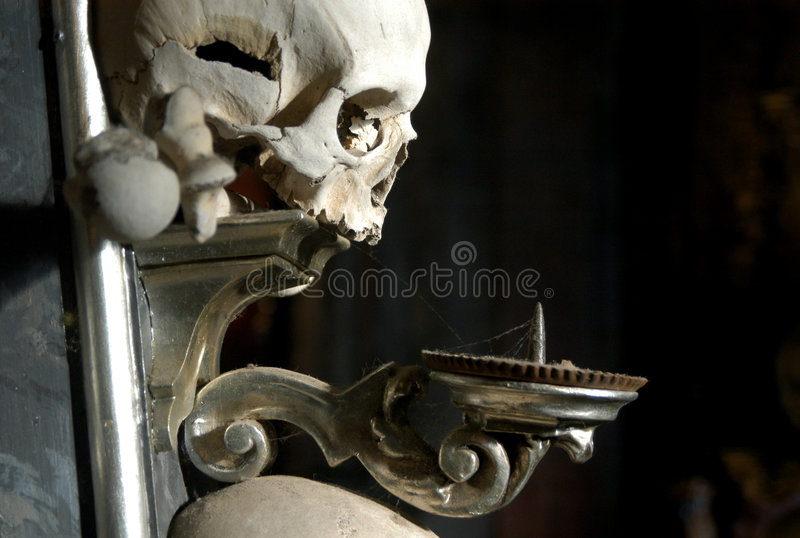 Candelabrum with a Human Skull. A candelabrum with a human skull and bones in the Ossuary at Sedlec near Kutna Hora, Czech Republic stock photography