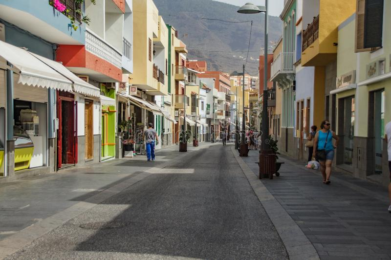 CANDELARIA, SPAIN - JANUARY 30: Some tourist are walking in a commercial street on January 30, 2016 in Candelaria, Tenerife, Spain royalty free stock images