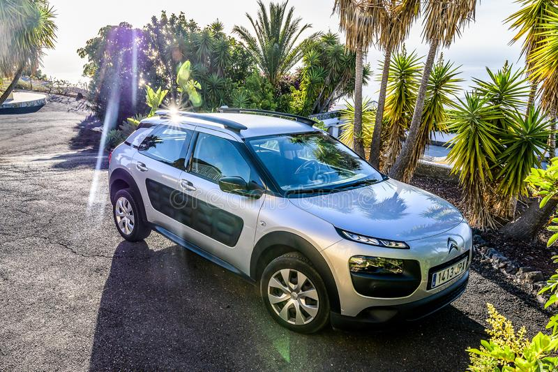 Candelaria Tenerife Spain 05.09.2019 Rental Car Citroen C4 is parked on a tropical parking lot with palms in the sun.  royalty free stock image