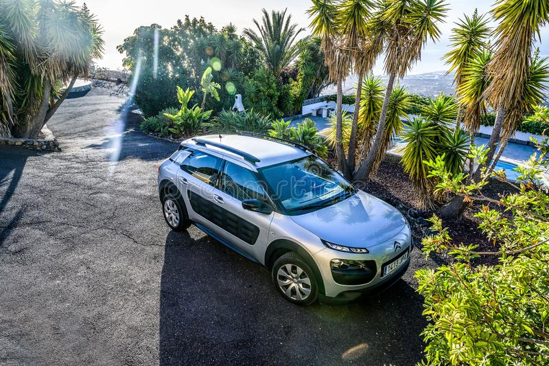 Candelaria Tenerife Spain 05.09.2019 Rental Car Citroen C4 is parked on a tropical parking lot with palms in the sun.  stock photos