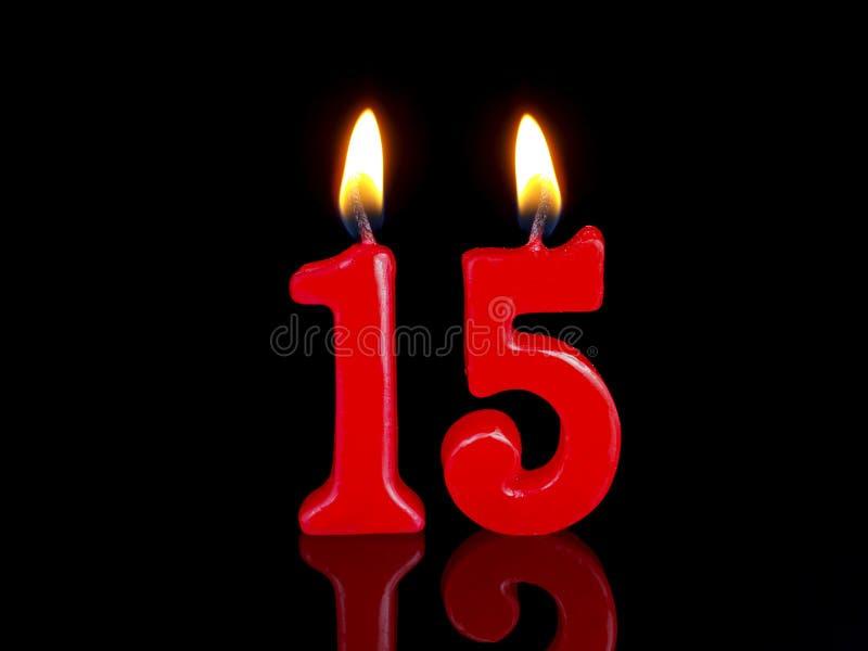 Candele di compleanno che mostrano Nr. 15 immagini stock