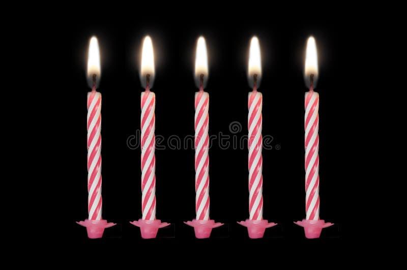 Candele di compleanno isolate su fondo nero immagini stock libere da diritti