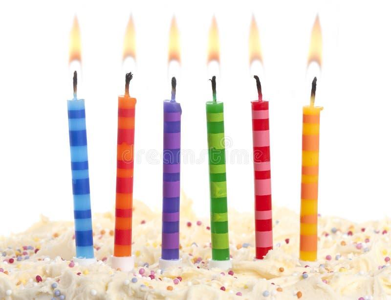 Candele di compleanno su bianco fotografie stock libere da diritti