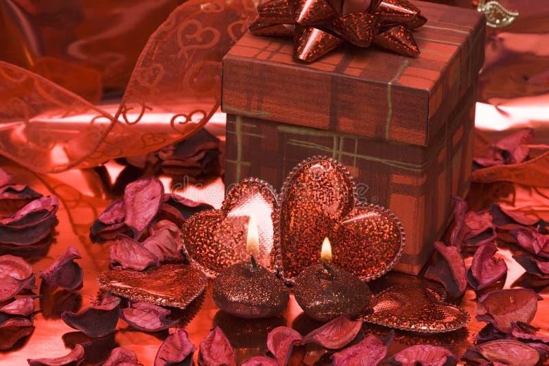 Candele rosse del cuore immagine stock