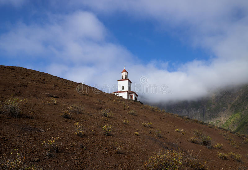 Candeleria Chapel in Frontera between green hills and mist. El Hierro, Spain, Canary Islands royalty free stock photography