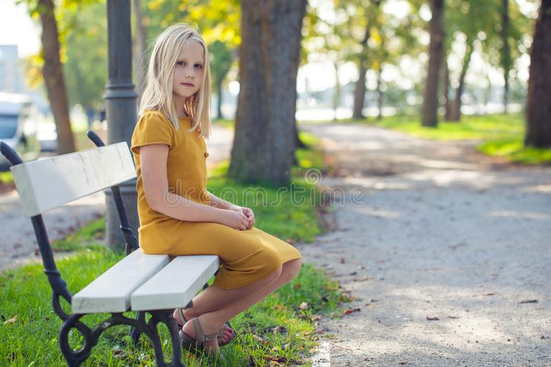 Candid child girl relaxing in park stock image