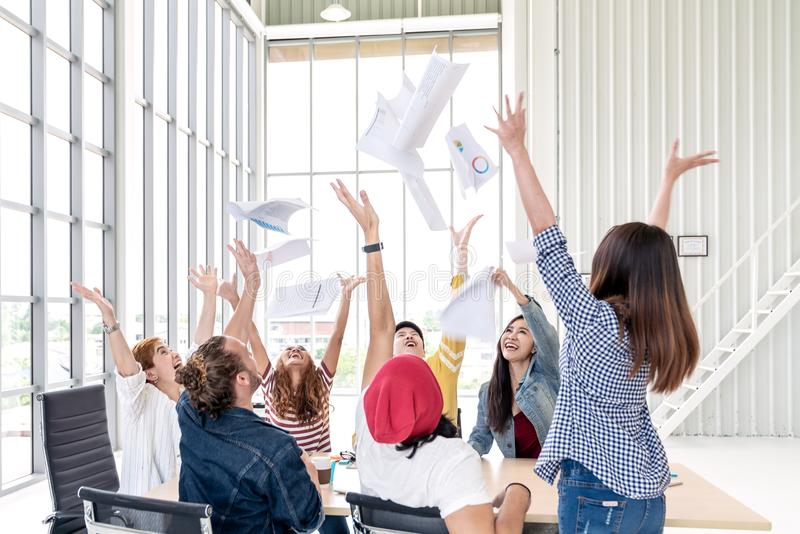 Candid group of young creative team employee prople throwing documents paper and feeling happy after work success at working place royalty free stock images