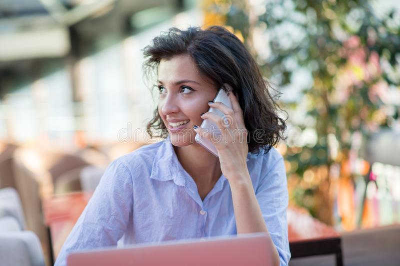 Candid image of a businesswoman working in a cafe. Selective focus. stock images