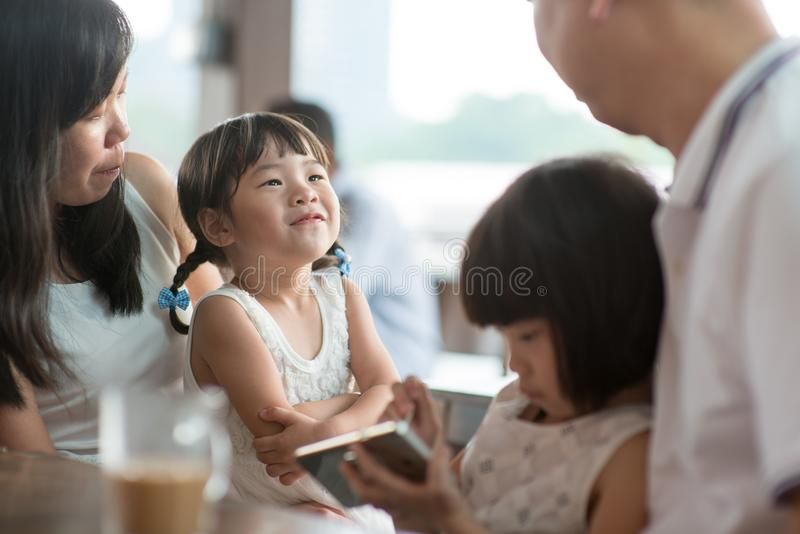 Candid photo of Asian family royalty free stock photography
