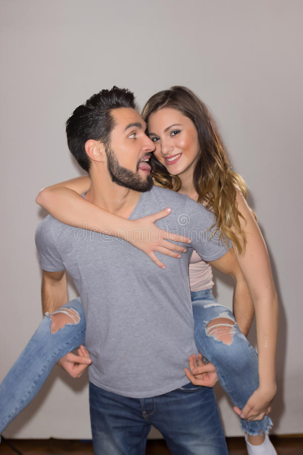 Candid portrait couple happy silly tongue out royalty free stock photography