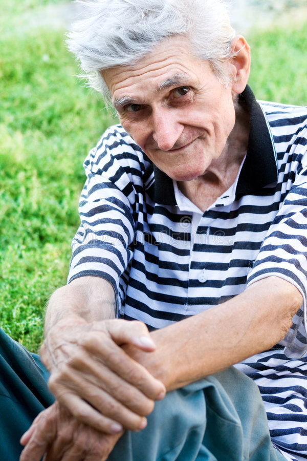 Candid Portrait Of Senior Man Outdoor Royalty Free Stock Images