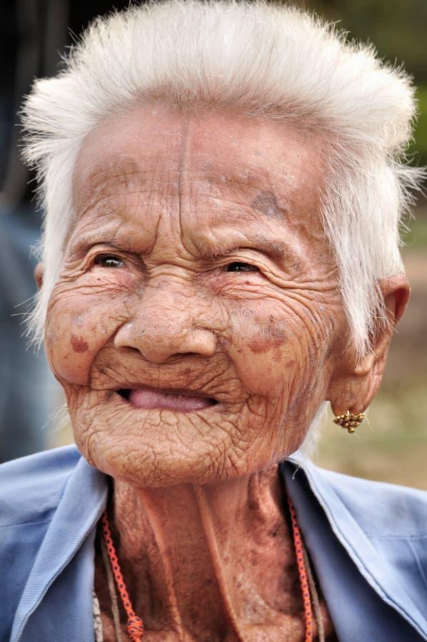 SUKHOTHAI, THAILAND - DECEMBER 15: Street portrait of Thai late 85's female at Wat Srichum temple in SUKHOTHAI THAILAND on DECEM stock images
