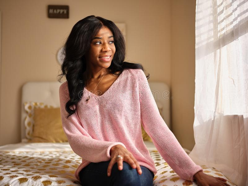 Candid portrait of young african american woman stock image