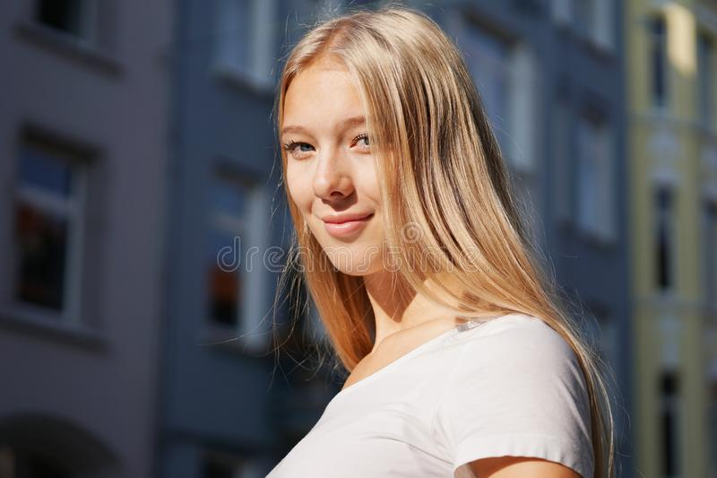 Candid urban street style portrait of blond young woman stock photo