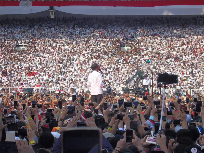 Candidates for President Joko Widodo campaign in front of hundreds of thousands of supporters at GBK Senayan. Jakarta, Indonesia - April 13, 2019: Candidates stock photo