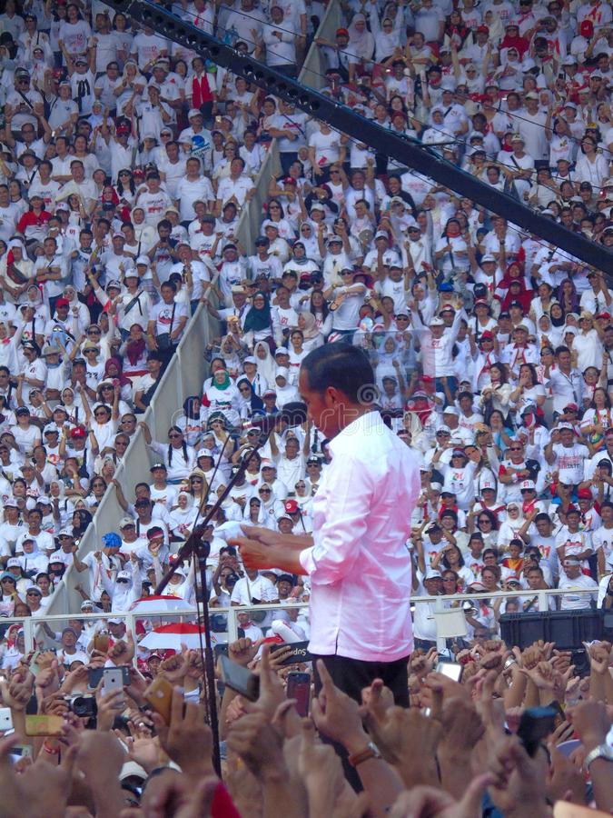 Candidates for President Joko Widodo campaign in front of hundreds of thousands of supporters at GBK Senayan. Jakarta, Indonesia - April 13, 2019: Candidates royalty free stock photo