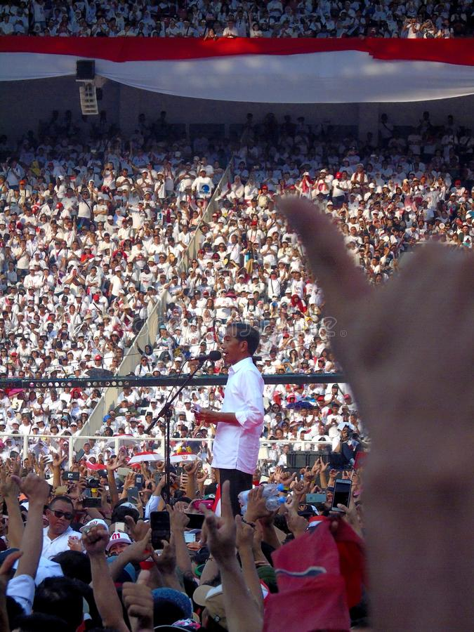 Candidates for President Joko Widodo campaign in front of hundreds of thousands of supporters at GBK Senayan. Jakarta, Indonesia - April 13, 2019: Candidates stock image