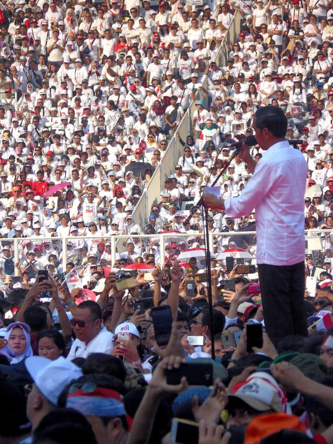 Candidates for President Joko Widodo campaign in front of hundreds of thousands of supporters at GBK Senayan. Jakarta, Indonesia - April 13, 2019: Candidates stock photos