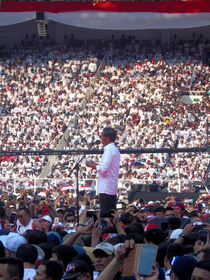 Candidates for President Joko Widodo campaign in front of hundreds of thousands of supporters at GBK Senayan. Jakarta, Indonesia - April 13, 2019: Candidates stock photography