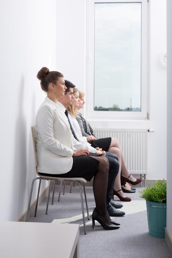 Candidates waiting for job interview stock photography