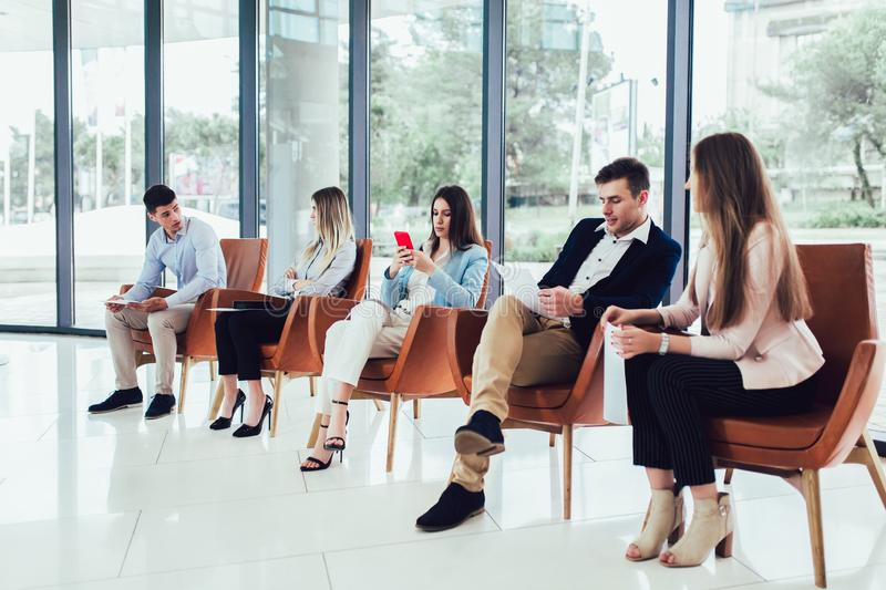 Candidates waiting for a job interview royalty free stock photo