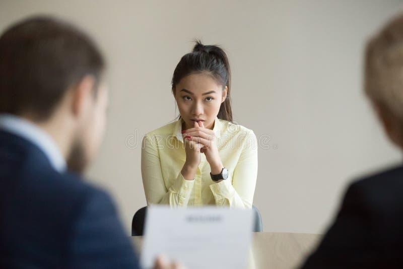 Candidato asiático nervioso subrayado en la entrevista de trabajo fotos de archivo libres de regalías
