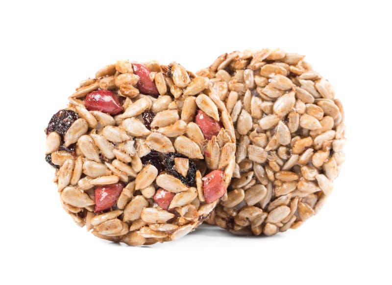 2 candied зажаренных в духовке семена подсолнуха арахисов стоковые фото