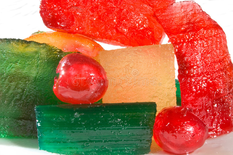 Candied fruits. Close-up of Colored candied fruits for desserts and cakes stock photos