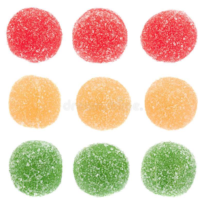 Candied round fruit jelly on white stock photos