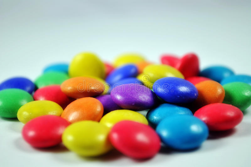 Candies. Very colorful chocolate coated candies, fun and sweet stock photos