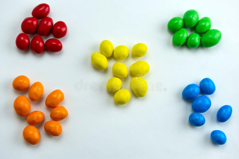 Candies arranged in a handful by colors. Colorful candies arranged in a handful by colors stock images