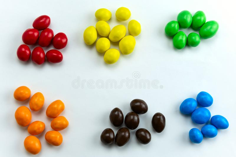 Candies arranged in a handful by colors. Colorful candies arranged in a handful by colors stock photos