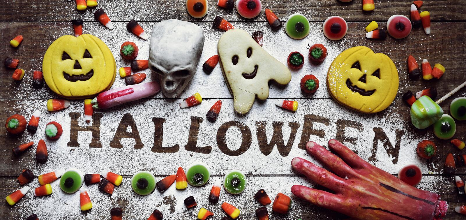 Candies, cookies and word Halloween stock photo