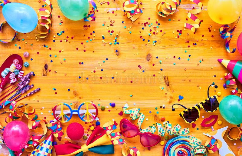 Colorful carnival accessories on table stock image