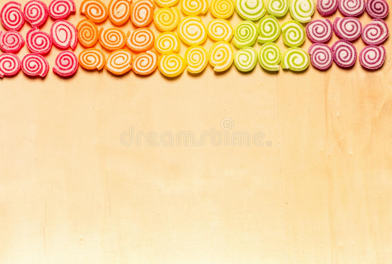 Candies and jellies colorful sweets on wood background stock photography