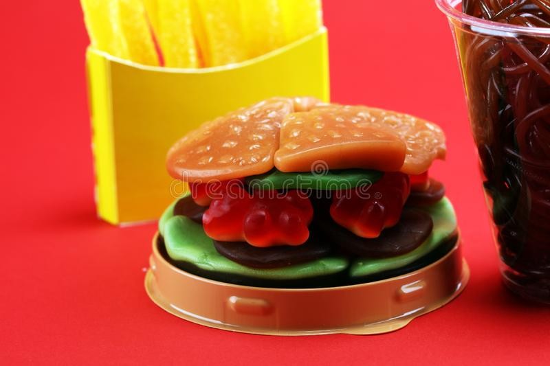 candies with jelly and sugar. colorful array of different childs sweets and treats. candy burger, fries and soft drink. royalty free stock image