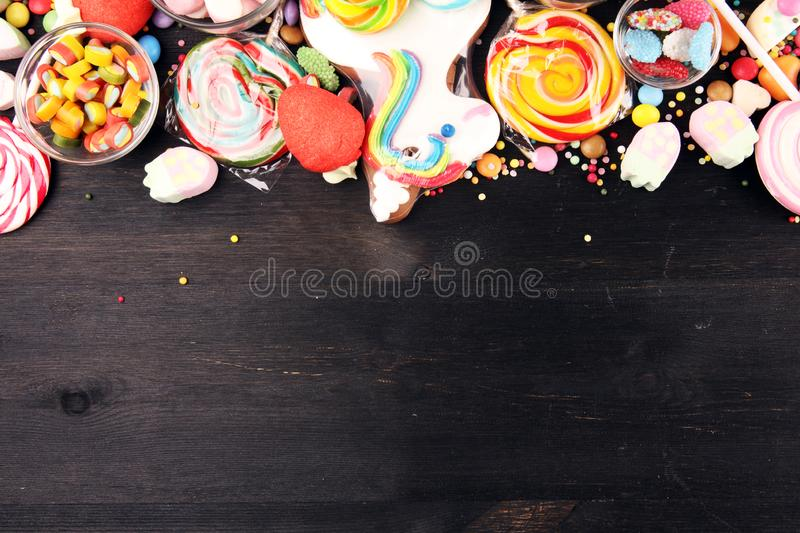 Candies with jelly and sugar. colorful array of different childs sweets and treats on table stock images