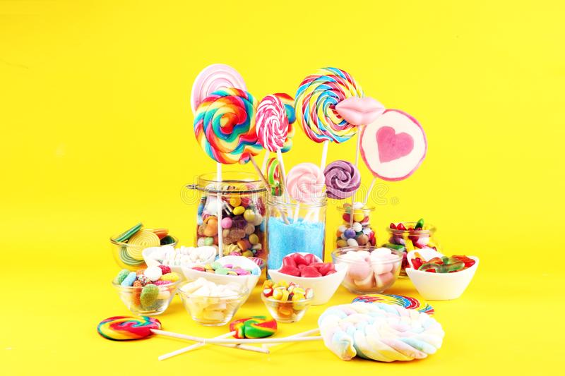 Candies with jelly and sugar. colorful array of different childs sweets and treats royalty free stock photos
