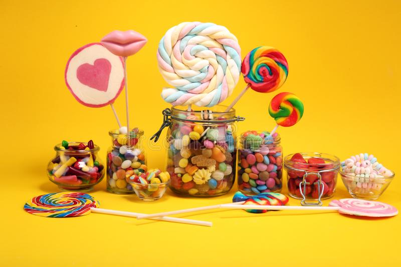 Candies with jelly and sugar. colorful array of different childs sweets and treats stock photography