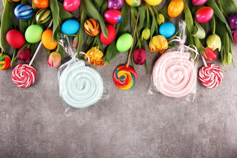 Candies with jelly and sugar with tulips and easter eggs royalty free stock photos