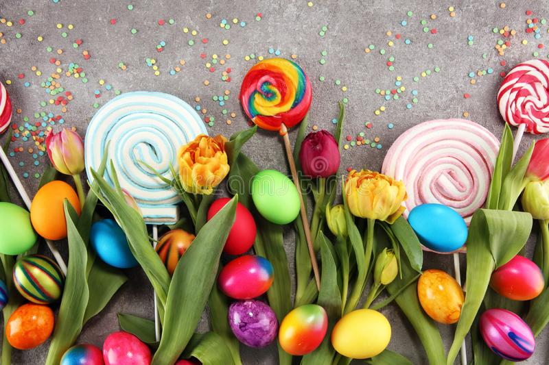 Candies with jelly and sugar with tulips and easter eggs stock photo