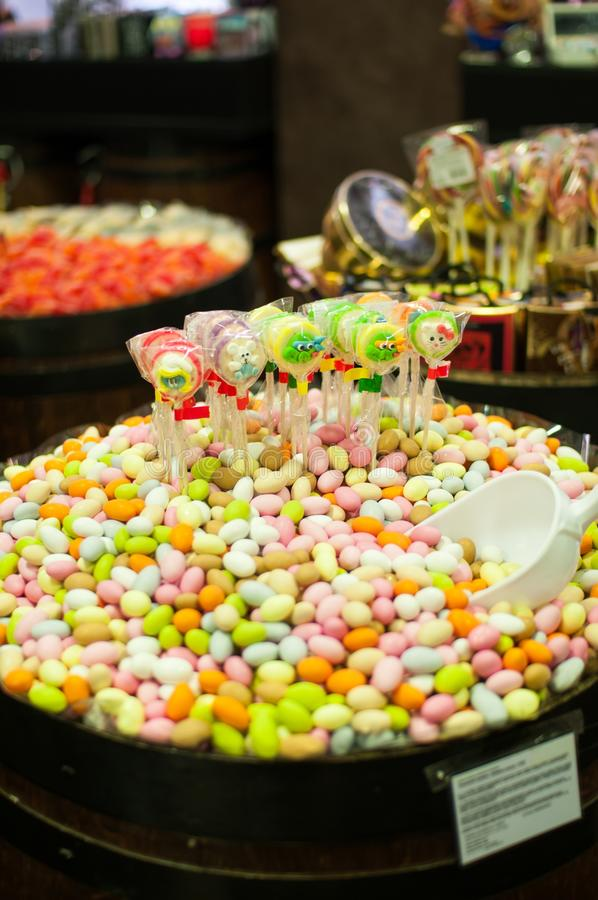 Candies and jellys in barrels stock photography