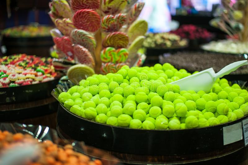 Candies and jellys in barrels stock photos