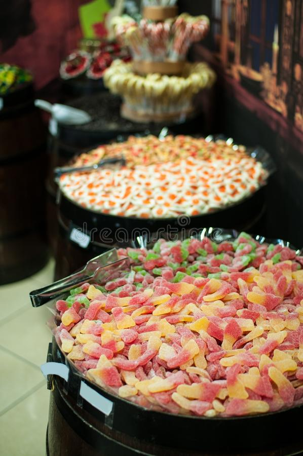 Candies and jellys in barrels royalty free stock photography