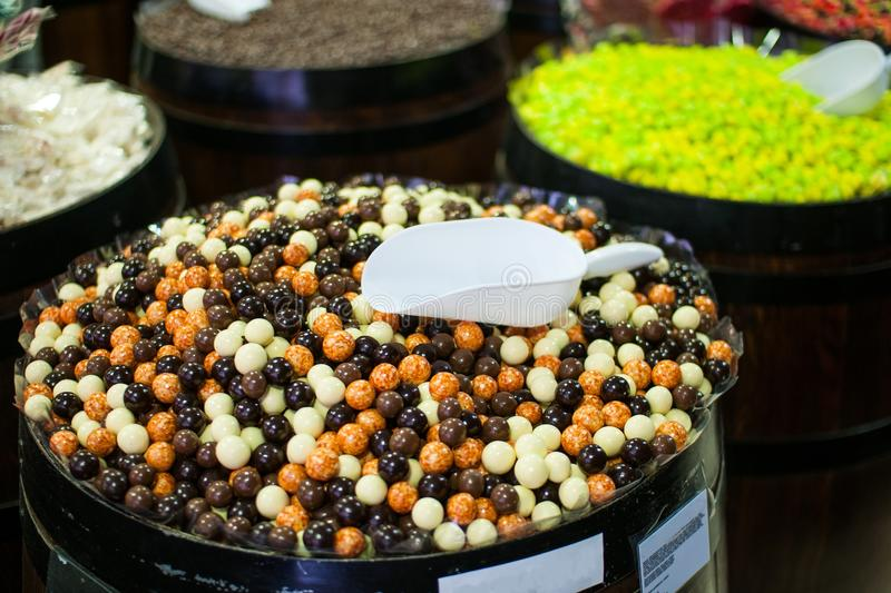 Candies and jellys in barrels royalty free stock image